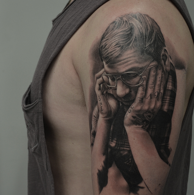 Black And Grey Man Portrait Tattoo On Man Left Half Sleeve By Ben Thomas