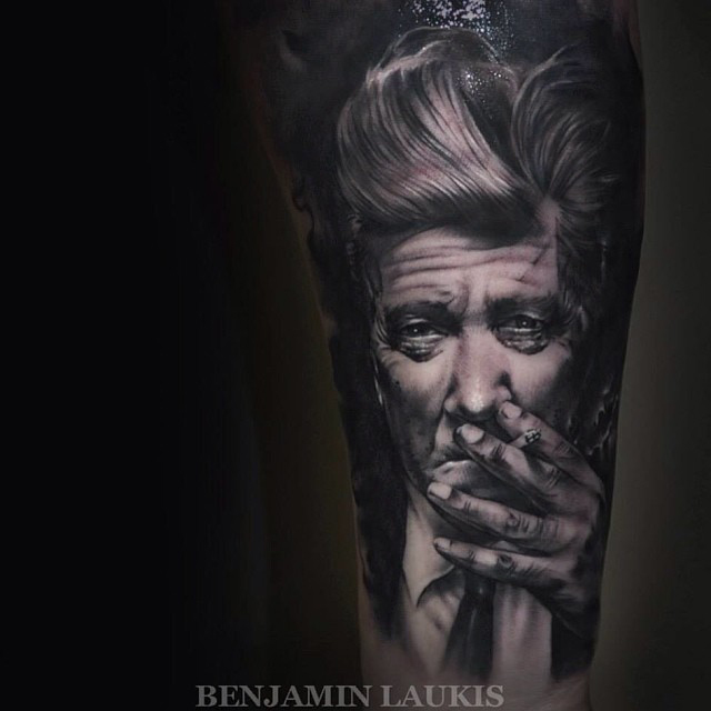 Black And Grey Smoking Man Portrait Tattoo On Left Forearm By Benjamin Laukis