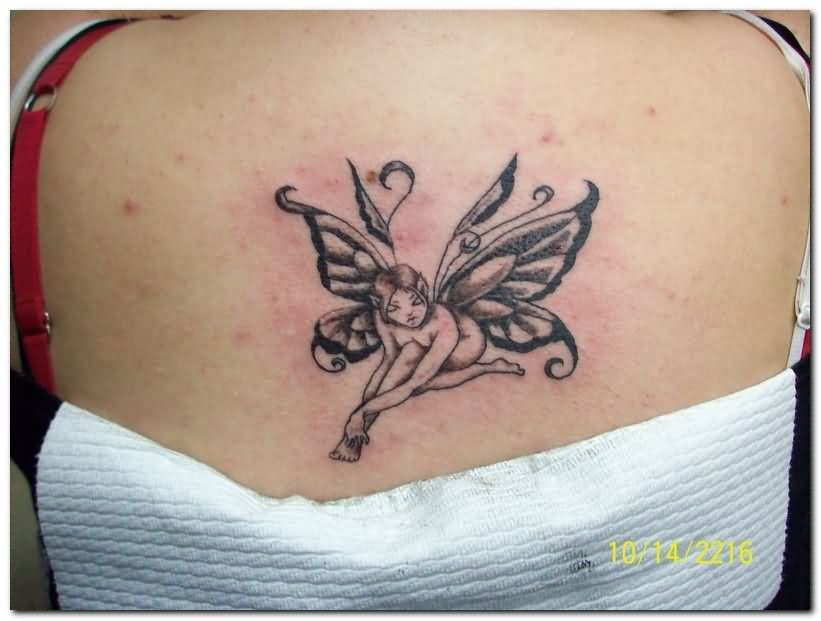 Black Ink Fairy Tattoo On Women Upper Back
