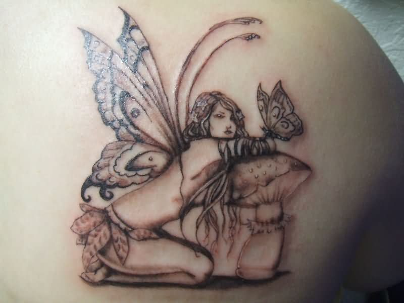 Black Ink Fairy With Mushroom And Butterfly Tattoo On Right Back Shoulder