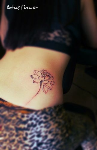Black Ink Lotus Flower Tattoo On Girl Right Hip