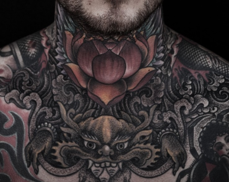 Black Ink Lotus Tattoo On Man Neck by Thomas Hooper