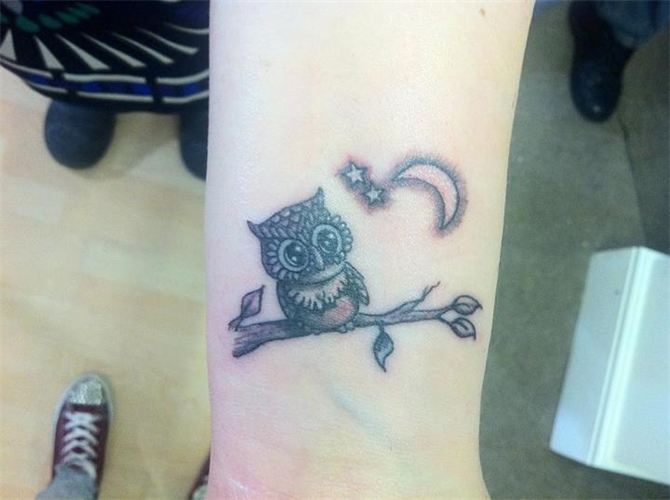 Black Ink Owl On Branch With Half Moon And Stars Tattoo On Wrist