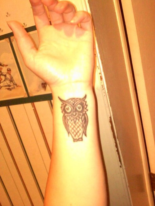 Black Ink Owl Tattoo On Left Wrist