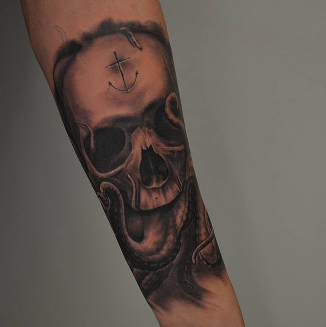 Black Ink Skull With Octopus Tattoo On Left Forearm By Ben Thomas