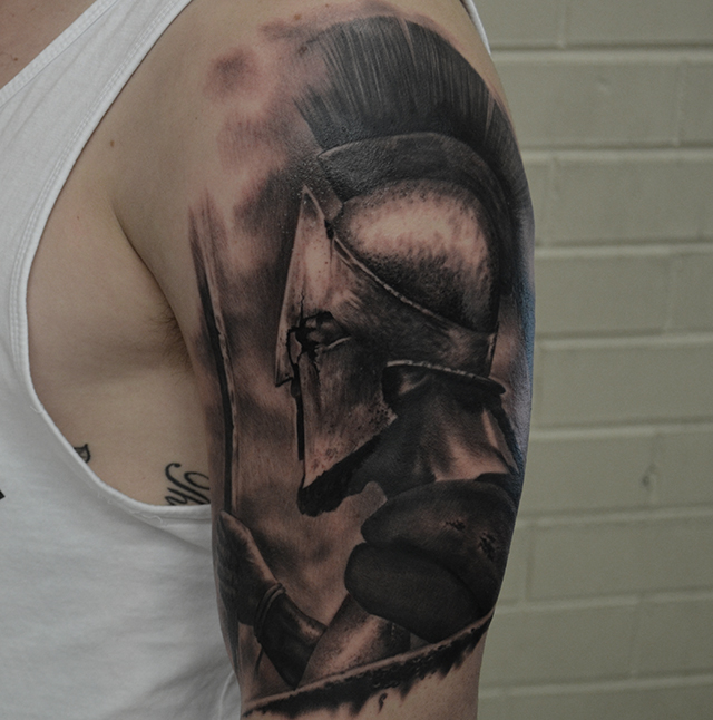 Black Ink Warrior Tattoo On Man Left Half Sleeve By Ben Thomas