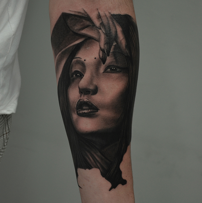 Black Ink Women Face Tattoo On Left Forearm By Ben Thomas