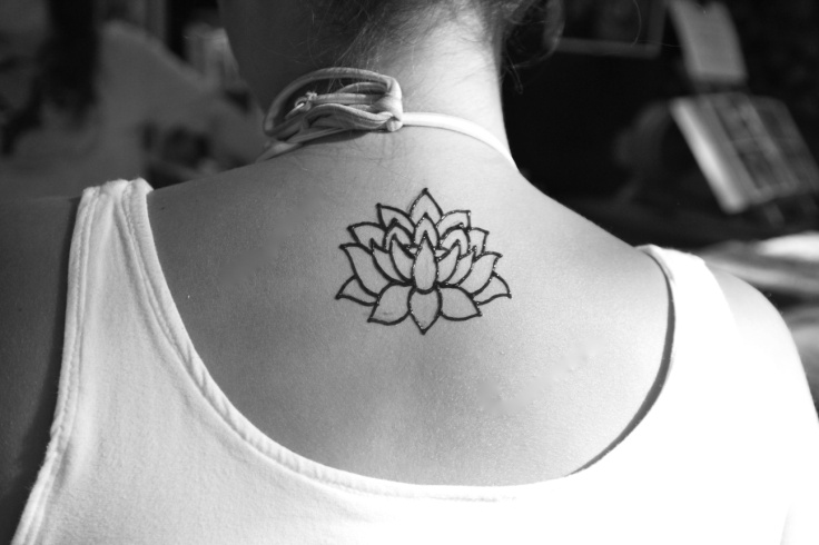 Black Outline Lotus Flowers Tattoo On Girl Back Neck