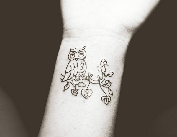 Black Outline Owl On Branch Tattoo On Wrist