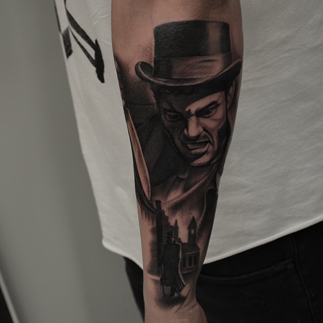 Blck Ink Man Face Tattoo On Left Arm By Ben Thomas