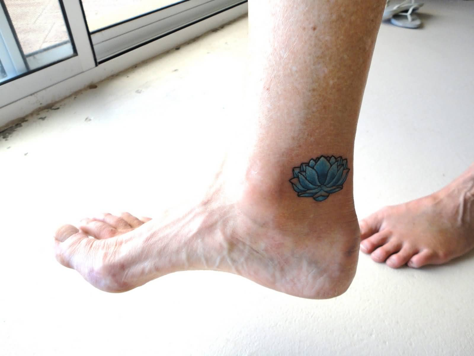 Blue Ink Lotus Flower Tattoo On Right Foot Ankle