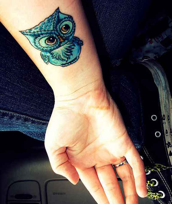 Blue Ink Owl Tattoo On Right Wrist
