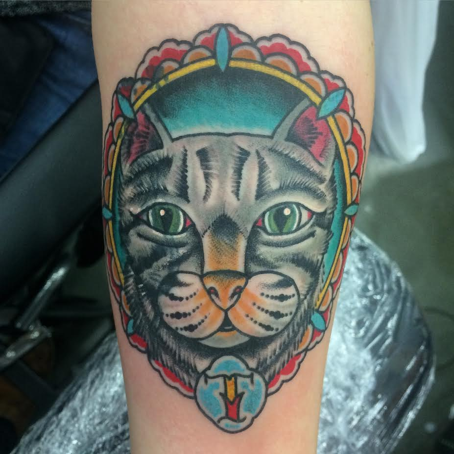 Cat Face in Frame Tattoo On Forearm By Justin Brooks