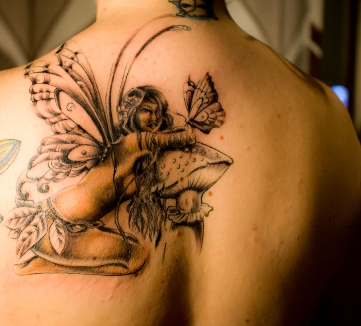 Classic Fairy With Mushroom And Butterfly Tattoo On Left Back Shoulder