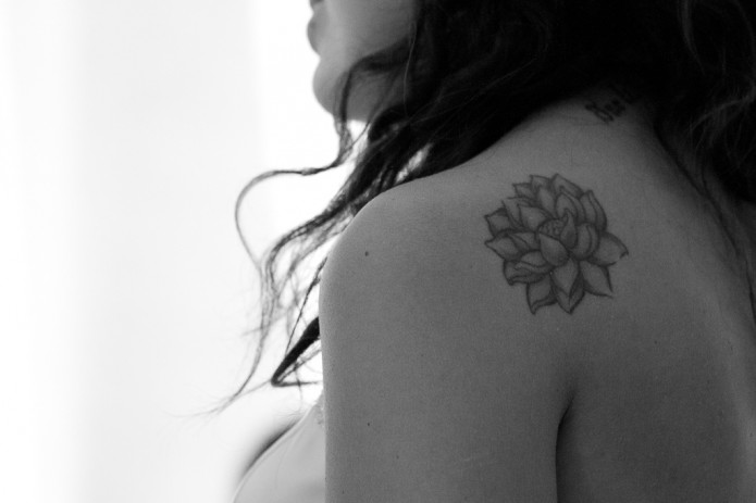 Classic Grey Ink Lotus Flower Tattoo On Girl Left Back Shoulder