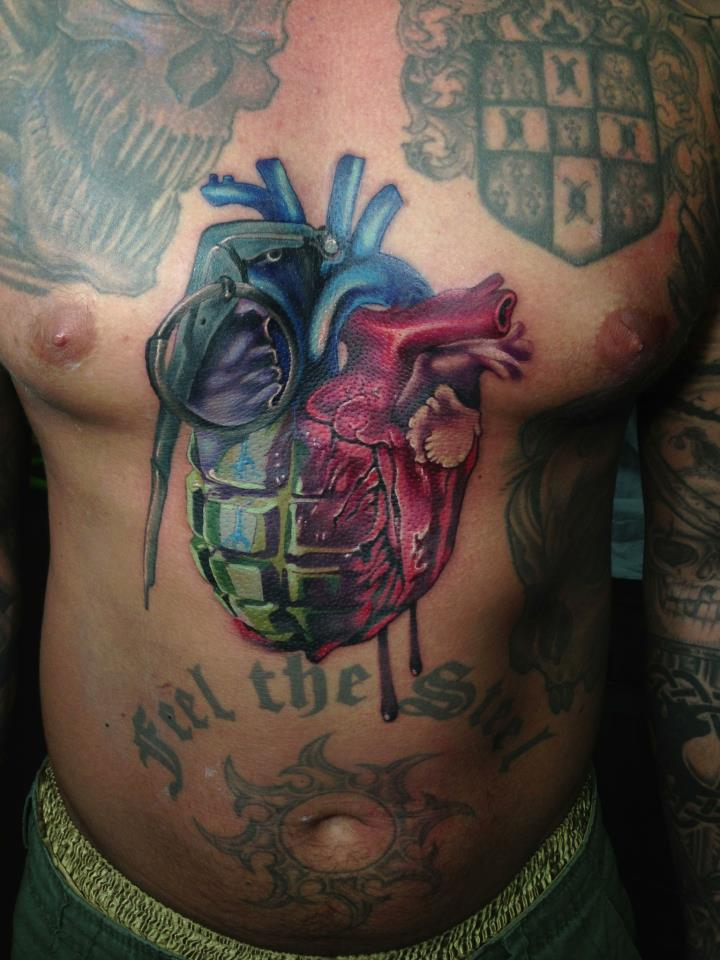 Colorful Grenade Real Heart Tattoo On Man Chest By Fabz