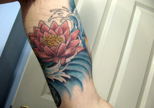 Colorful Lotus Flower In Water Tattoo On Left Bicep