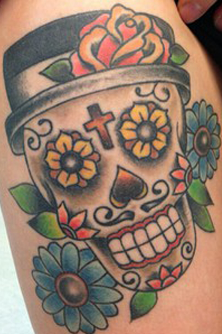 Colorful Sugar Skull With Flowers Tattoo Design By Roger McMahon