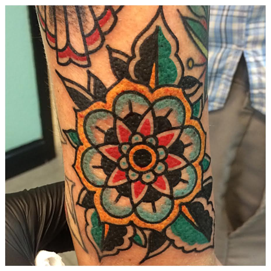 Colorful Traditional Flower Tattoo On Half Sleeve By Justin Brooks