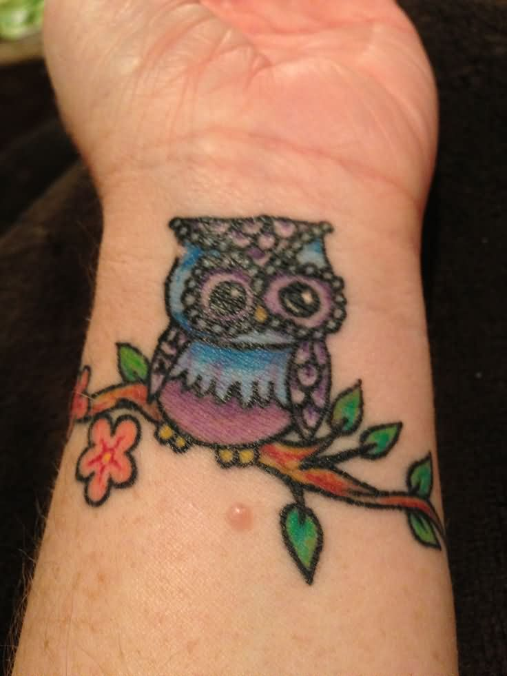Colorful Traditional Owl On Branch Tattoo On Left Wrist