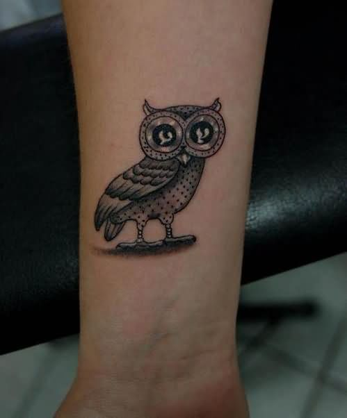 Cool Black Ink Owl Tattoo Design For Wrist