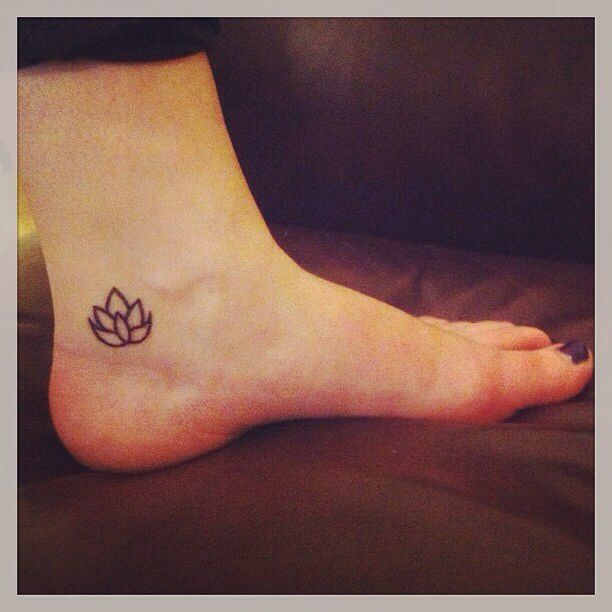 Cool Black Outline Lotus Tattoo On Girl Left Foot Ankle