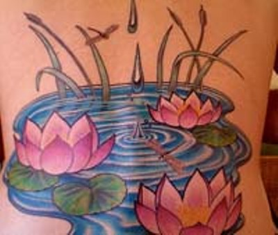 Cool Lotus Flowers In Water Tattoo Design For Back