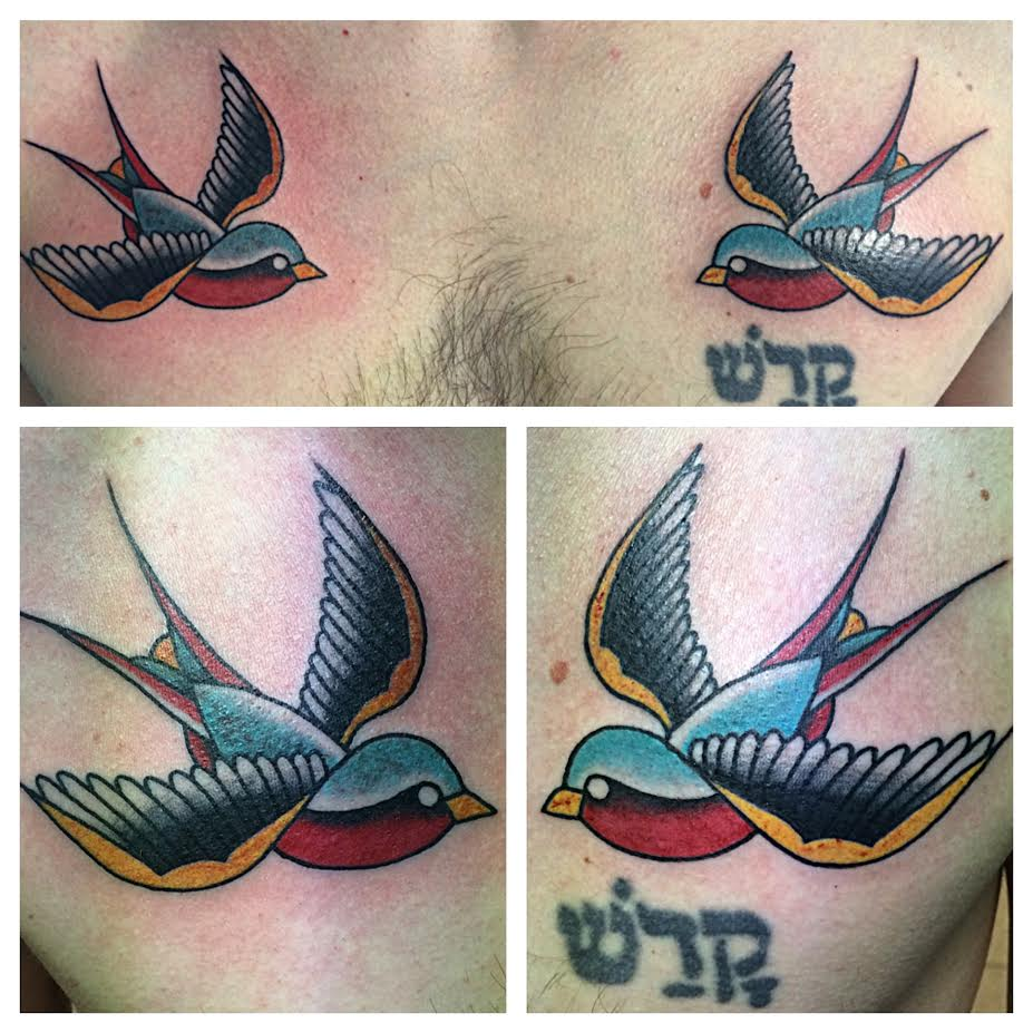 Cool Traditional Two Flying Birds Tattoo On Man Chest By Justin Brooks