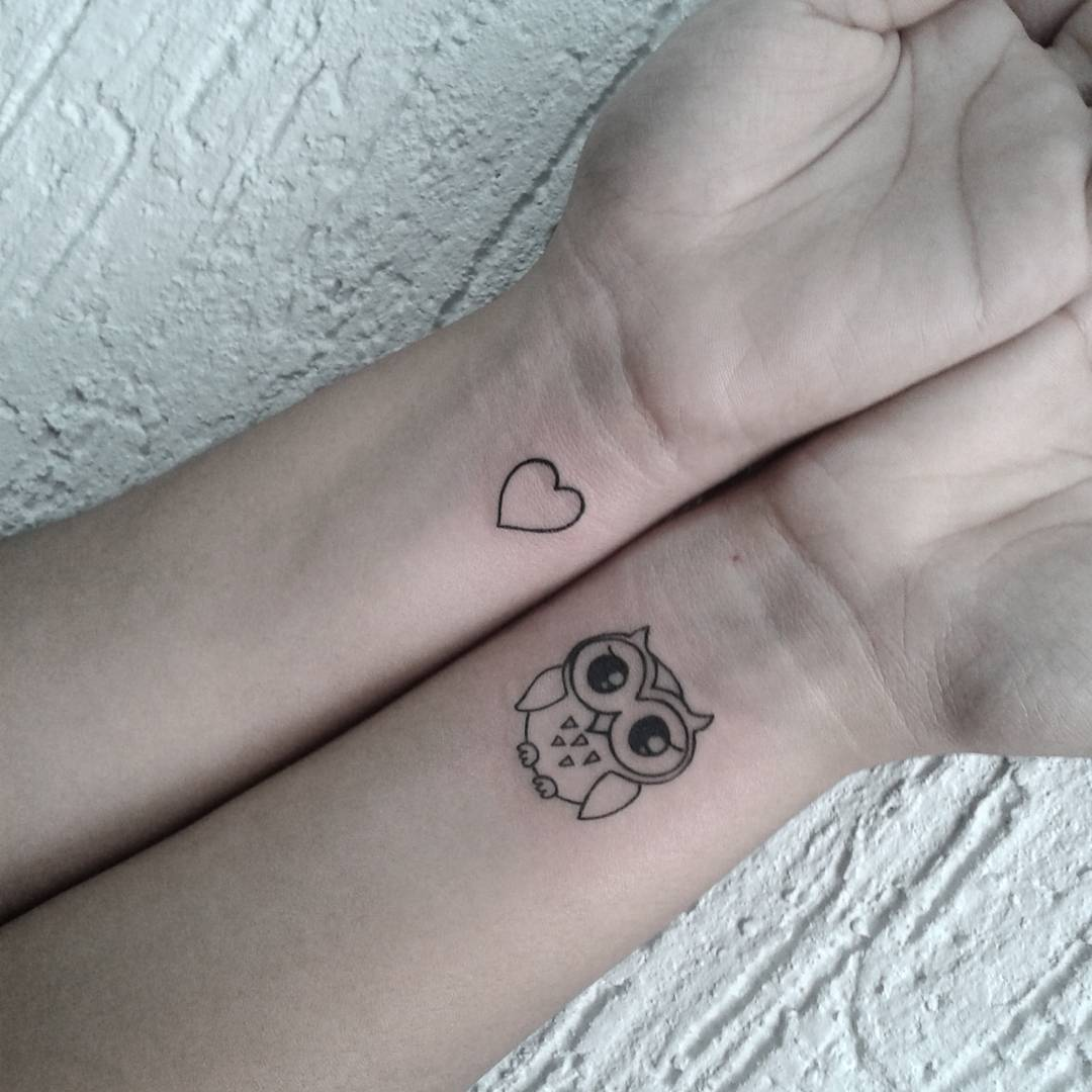 Cute Black Outline Owl And Heart Tattoo On Both Wrist