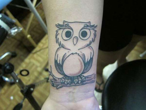 Cute Grey Ink Owl On Branch Tattoo On Right Wrist