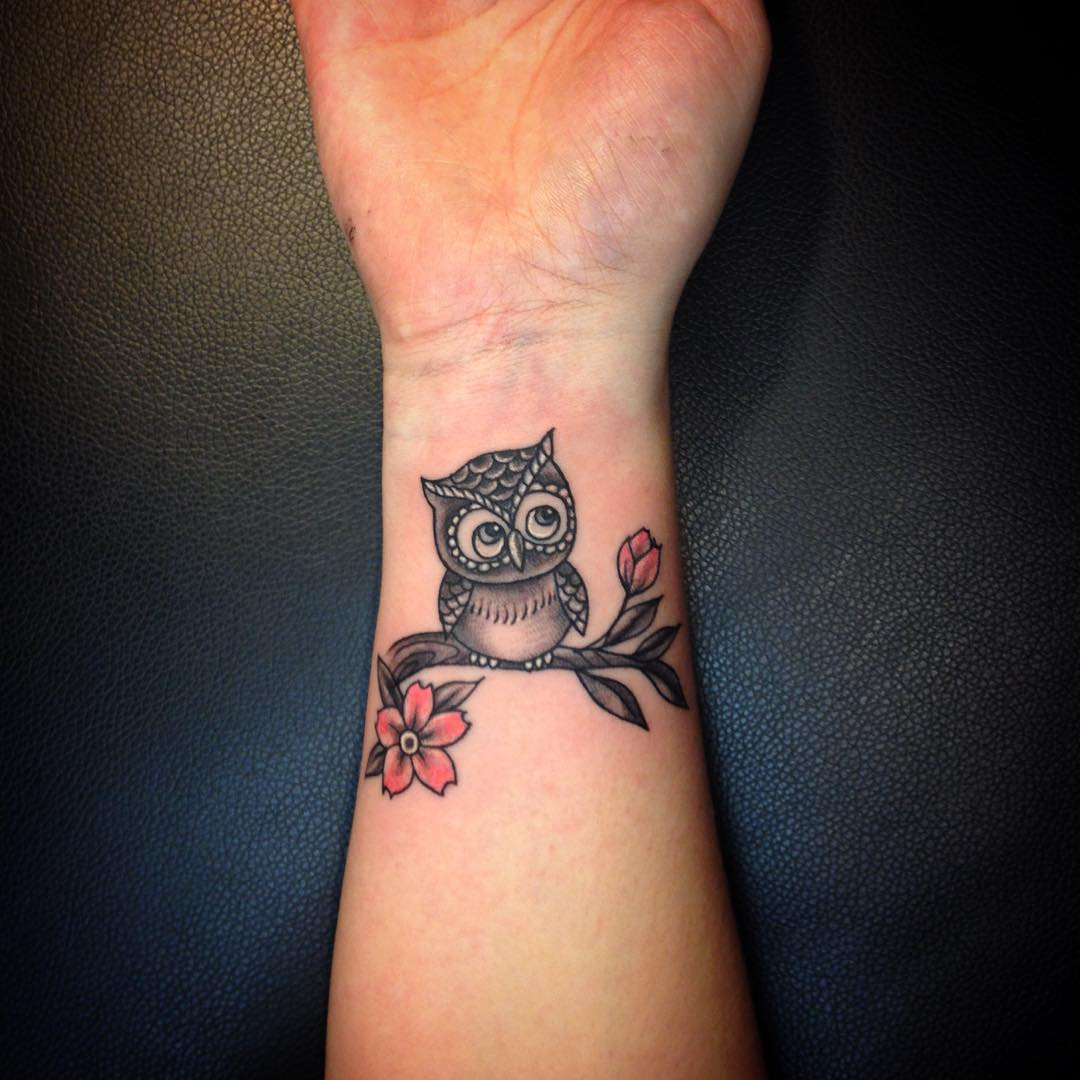 Cute Small Sitting Owl Tattoo On Wrist