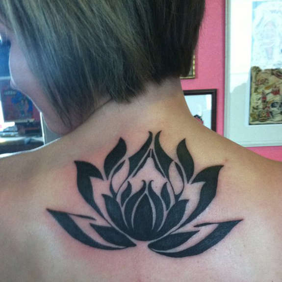Fantastic Black Ink Lotus Flower Tattoo On Girl Back Neck