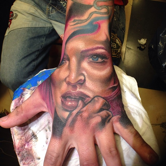 Fantastic Girl Face Tattoo On Left Hand By Fabz