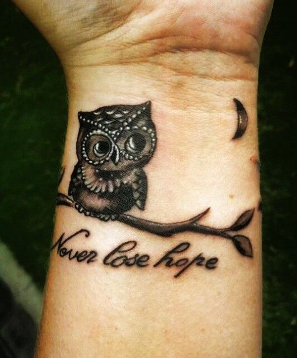Never Lose Hope - Black Ink Owl On Branch Tattoo On Left Wrist