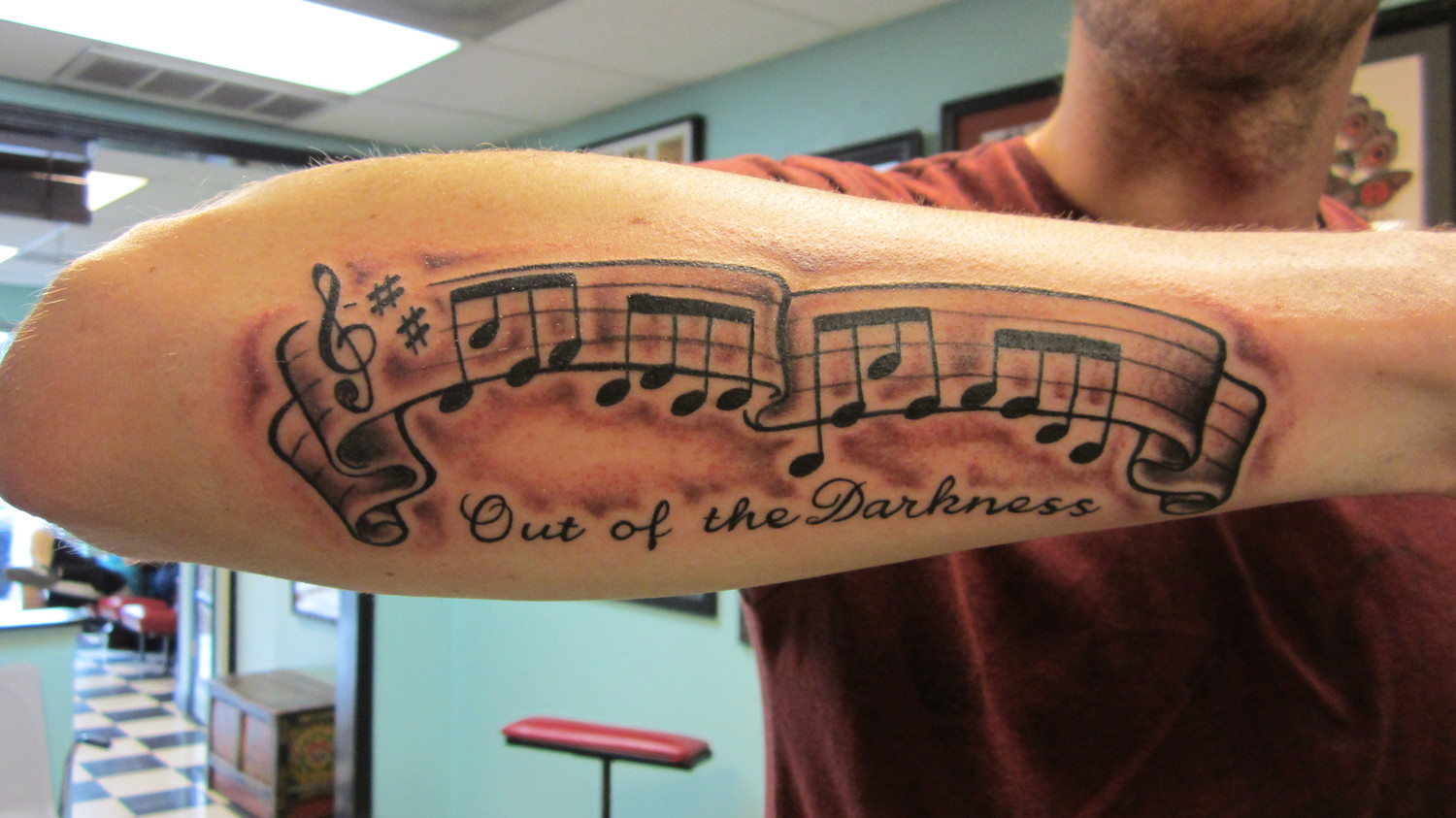 Out Of The Darkness - Black Ink Music Knots Tattoo On Man Right Arm By Roger McMahon