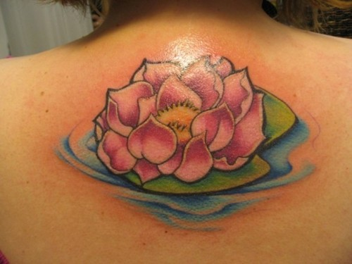 Pink Ink Lotus Flower In Water Tattoo On Girl Upper Back