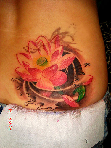Pink Ink Lotus Flower In Water Tattoo On Lower Back