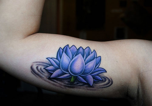 Purple Ink Lotus Flower In Water Tattoo On Right Bicep