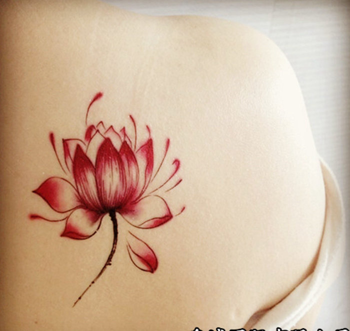 Red Ink Lotus Flower Tattoo On Right Back Shoulder