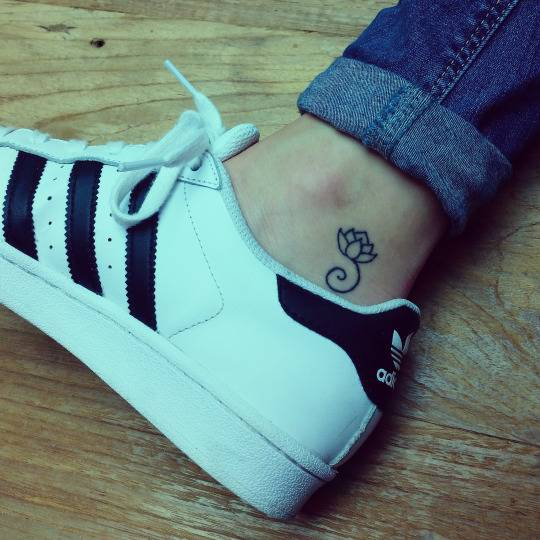 Simple Black Outline Lotus Flower Tattoo On Ankle