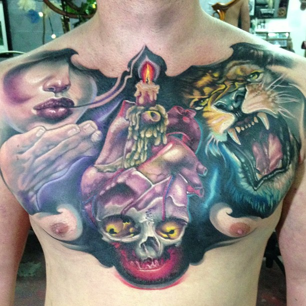Skull With Real Heart And Roaring Lion Head Tattoo On Man Chest By Fabz