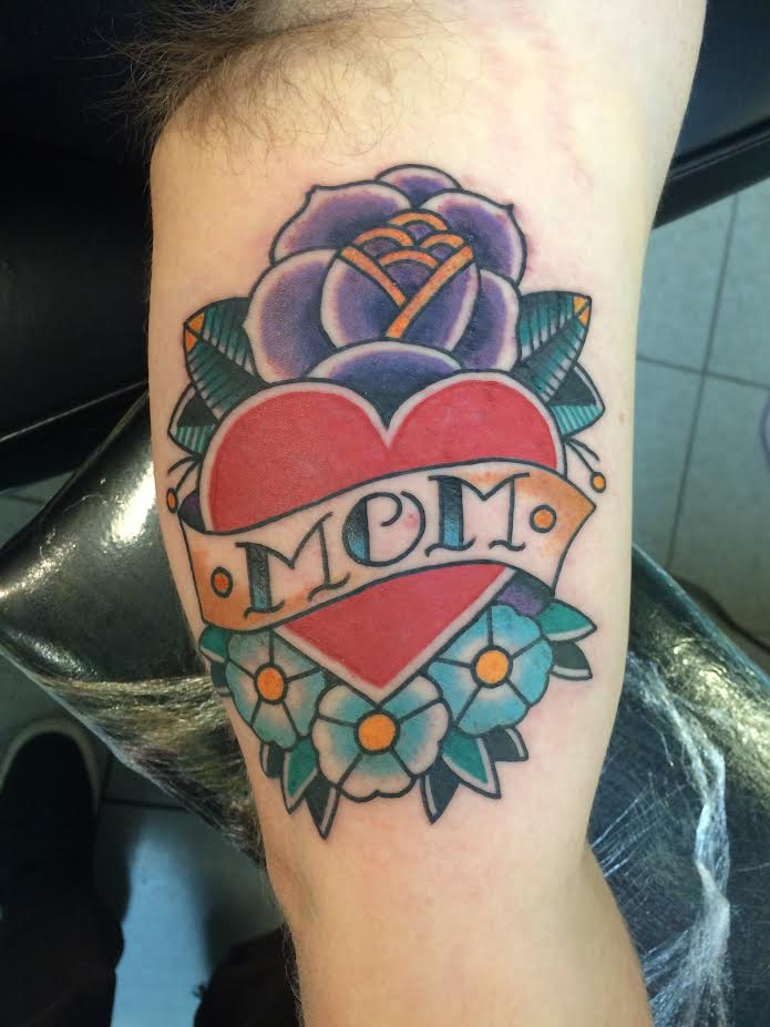 Traditional Heart With Flowers And Mom Banner Tattoo On Left Bicep By Justin Brooks