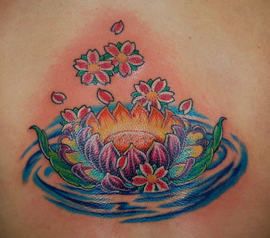 Traditional Lotus Flower In Water Tattoo Design