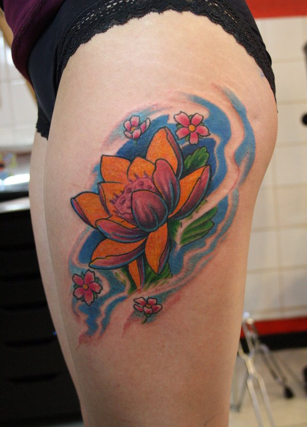Traditional Lotus Flower Tattoo On Girl Left Side Thigh By Ian