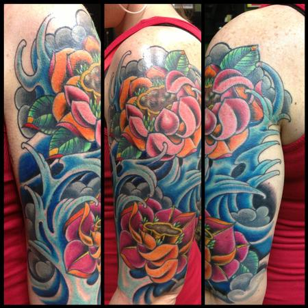 Traditional Lotus Flowers In Water Tattoo On Girl Left Half Sleeve