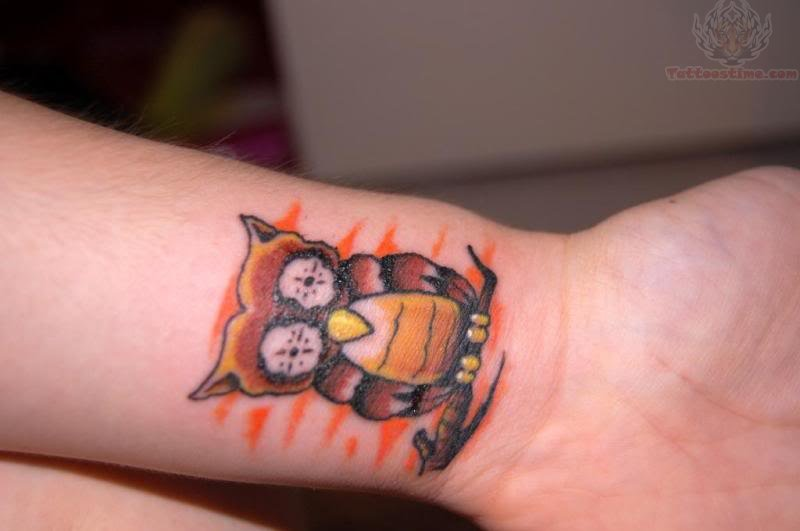 Traditional Owl Tattoo On Left Wrist