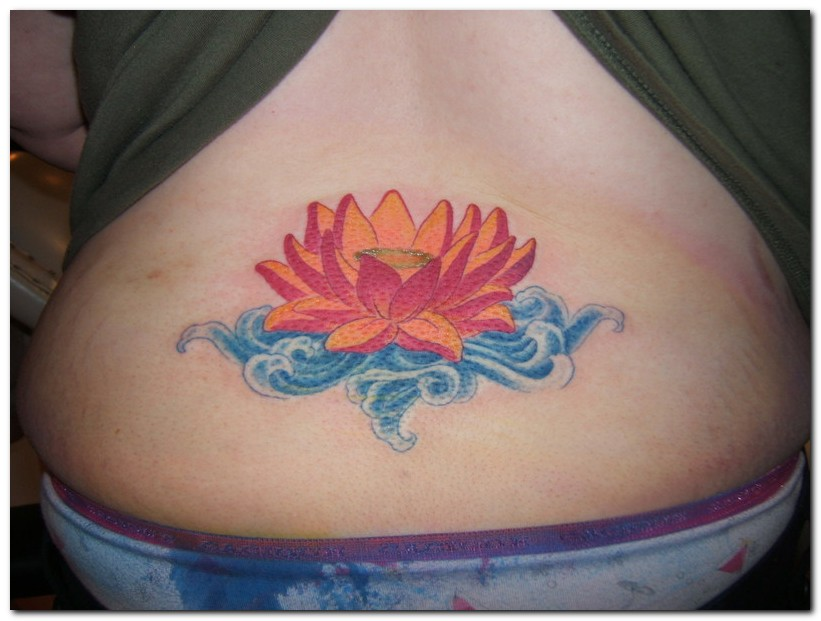 Wonderful Lotus Flower In Water Tattoo On Lower Back