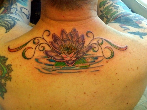 Wonderful Lotus Flower In Water Tattoo On Man Upper Back