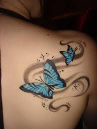 Amaze colored butterfly tattoo on back shoulder for her hot look