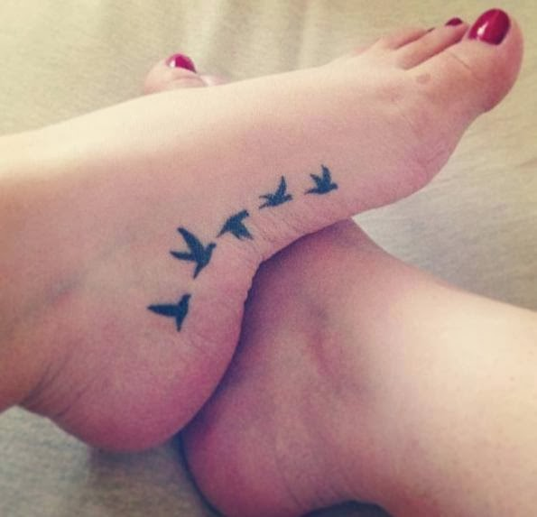 Amaze small bird tattoo on foot for lovely feet